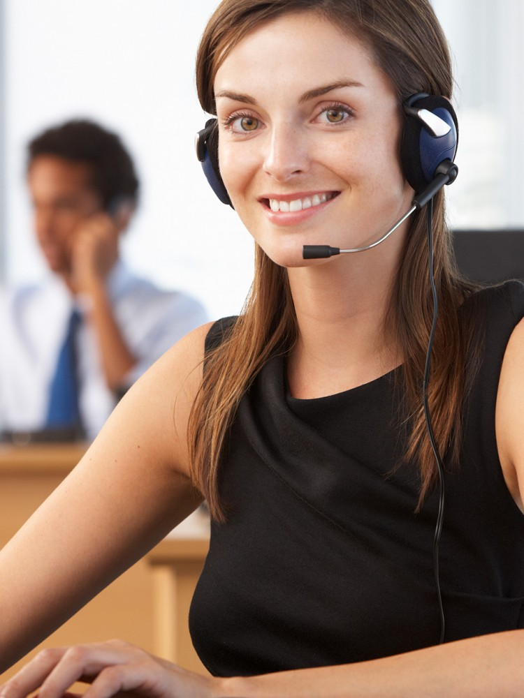 woman on headset looking at camera